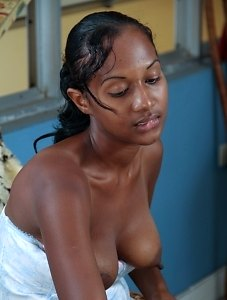 Sunita is sucking on her lollipop when she thinks of a better use for it. She strips off her blue corset and skirt before pleasuring her moist hairy p