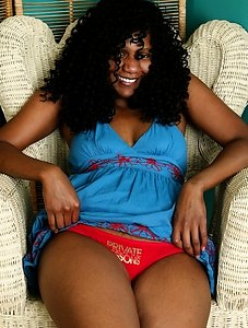 Phat babe Lena shows us her black snatch topped with some awesome hairy curls and nice big boobs too.