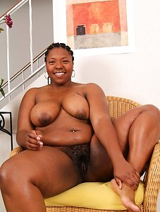 Nyla takes off her black underwear and toys around on a thatched chair her hairy pussy dripping wet.